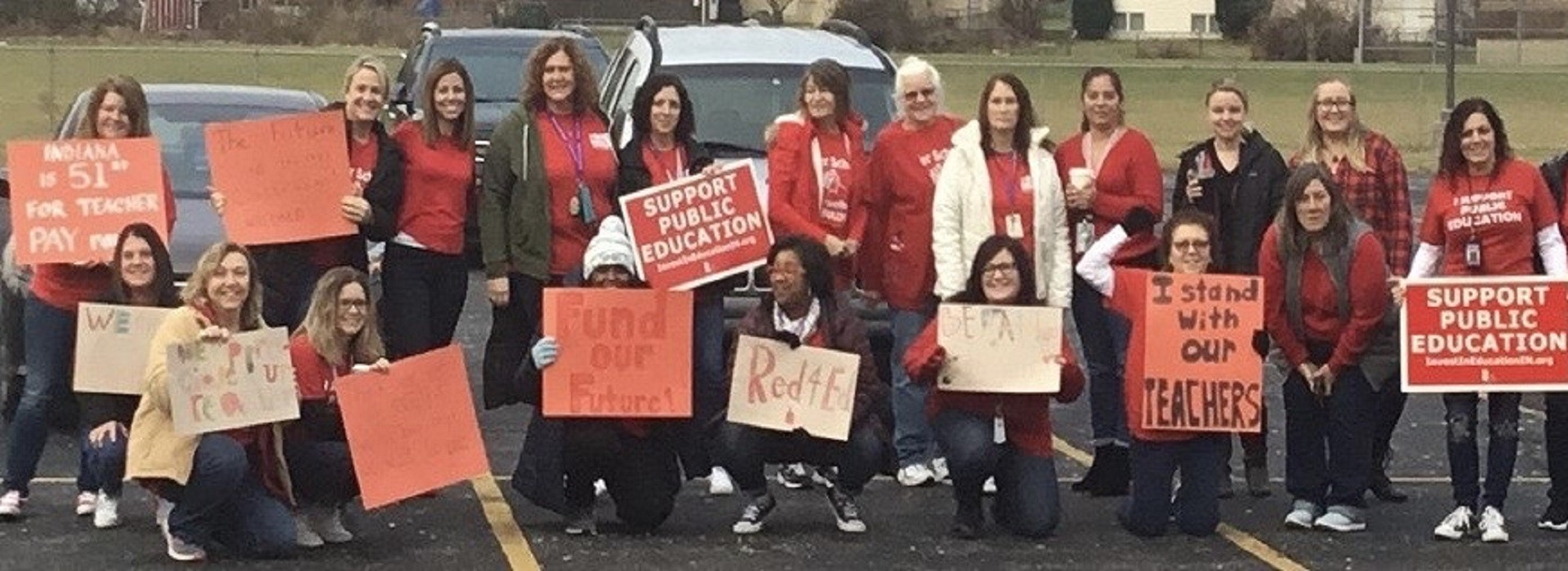 Teachers support Red 4 Ed with signs